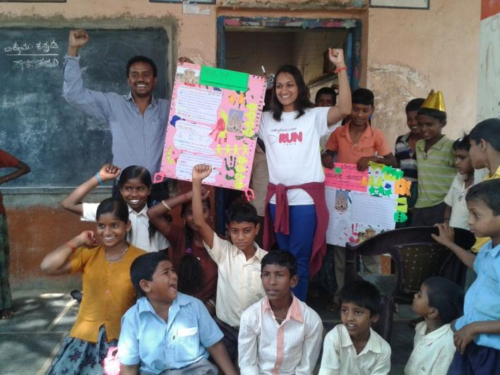 School children and Salesforce volunteers after completion of project work (poster) on Hampi
