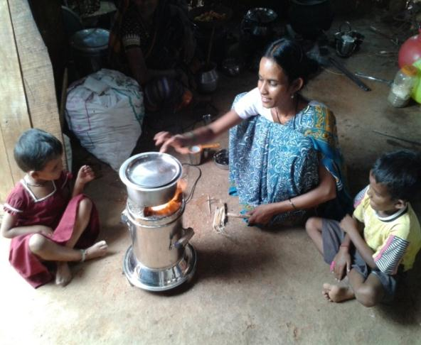 SHG women using Biomass cook stove for cooking