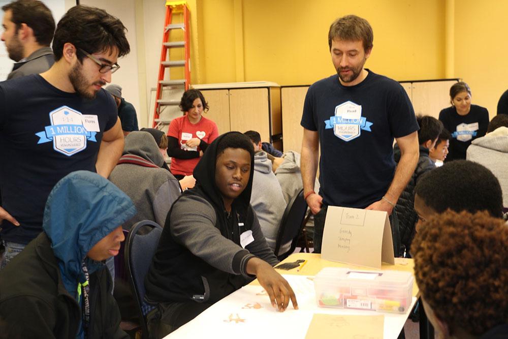 Salesforce volunteers with students