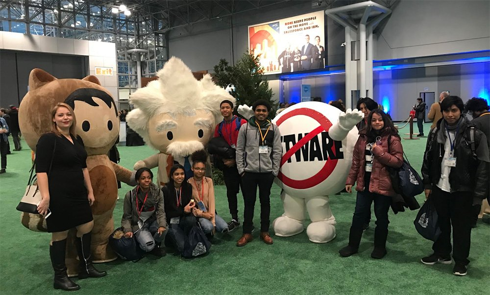 ScriptEd students posing with Salesforce mascots at World Tour