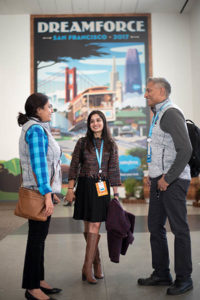 Advancement is about relationship building, much like networking at Dreamforce. Dreamforce attendees in conversation.