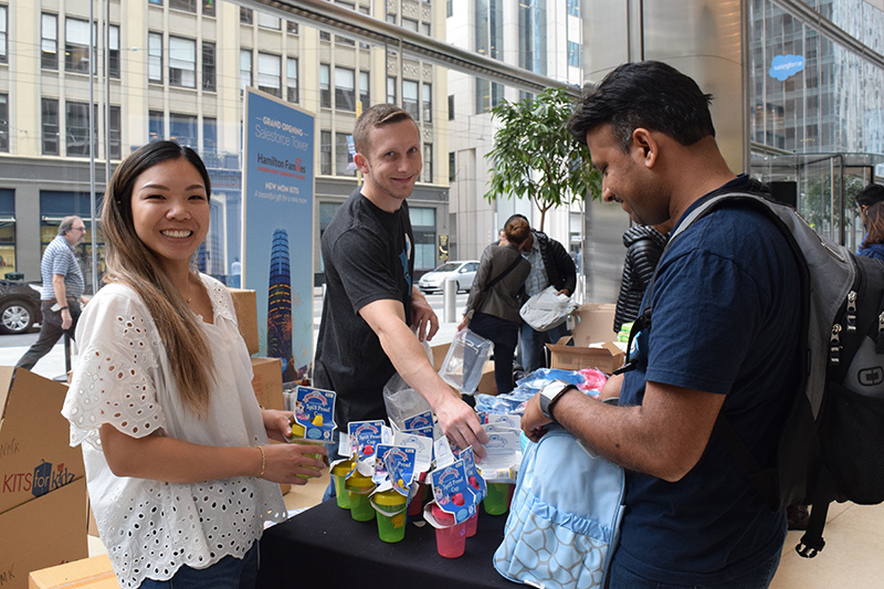 Volunteers put together kits to benefit a local nonprofit, at the opening of Salesforce Tower in 2018