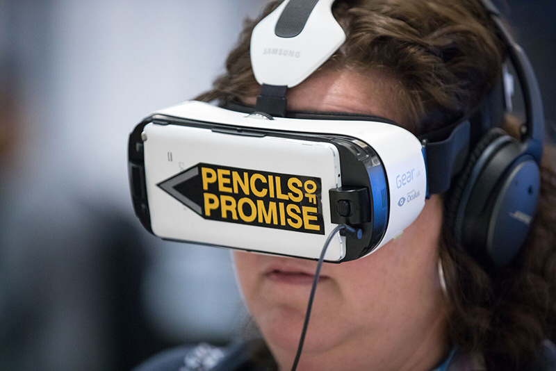 An attendee tries out new technology at Dreamforce