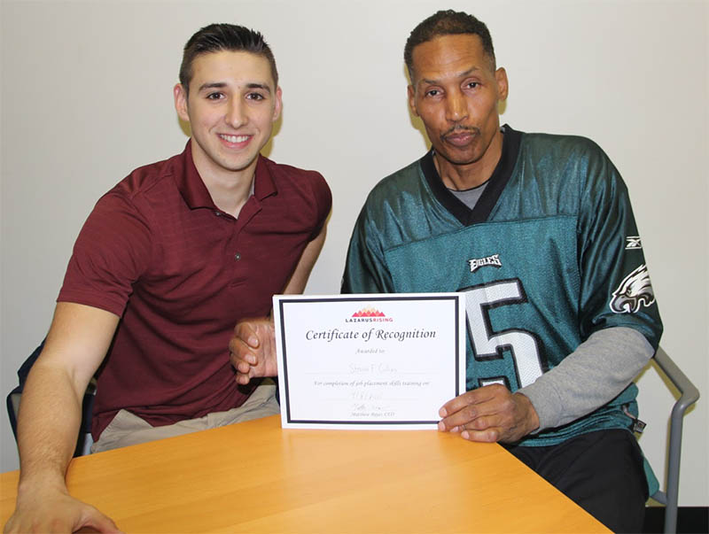 Volunteer Matthew Sobel (left) with Lazarus Rising program participant Steven Collins (right)