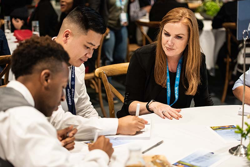 Salesforce volunteers help K-12 youth get Future Ready at a career coaching event at Future Executive Summit, Dreamforce 2018
