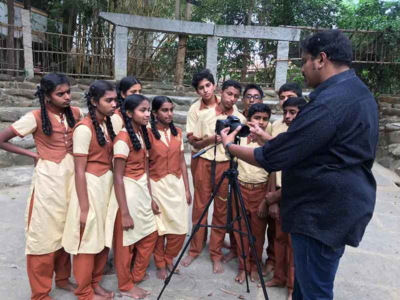 Students in Bangalore learning about film making and editing from a Salesforce employee