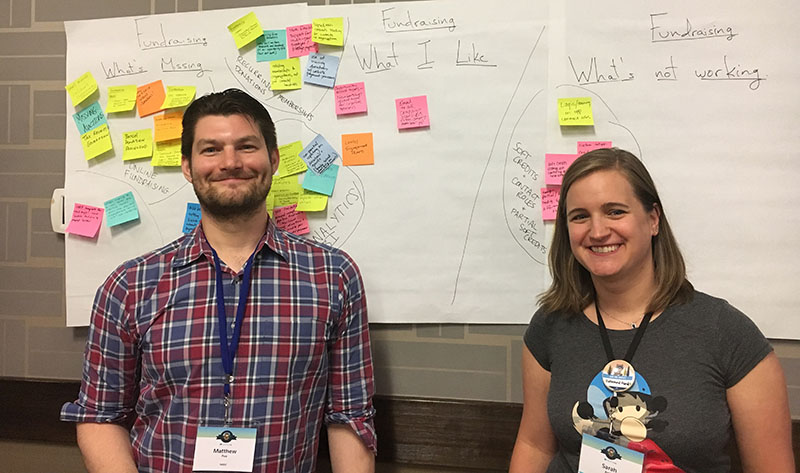 Matthew Poe and Sarah Amin in front of NPSP/nonprofit CRM related ideas at the Denver Open Source Community Sprint, summer 2018