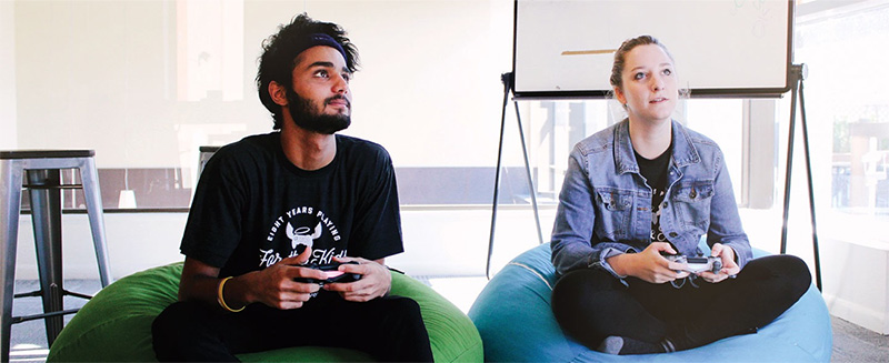 Two members of the DonorDrive staff using Live Fundraising™ at a virtual gaming event to benefit children's hospitals.