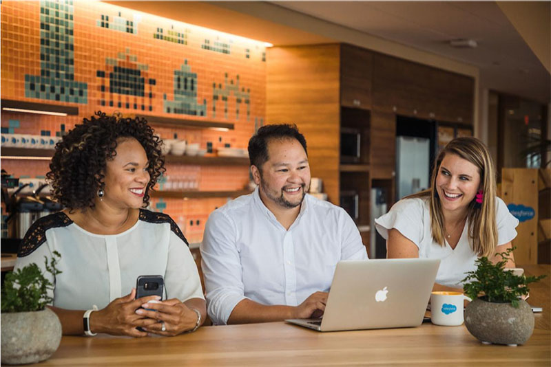 A group of Salesforce employees participating in a meeting