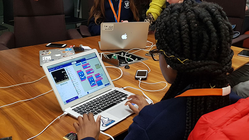 A student works on a coding challenge at Computer Science Education Week with Salesforce employees in Dublin, Ireland.