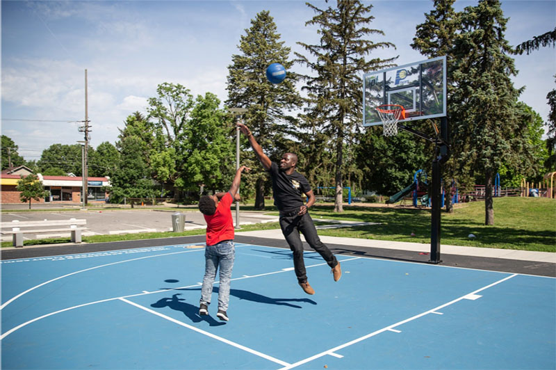 Big Brother Bunmi Akintomide and Little Brother Jerry playing basketball together in Indianapolis. Having a Big (a mentor) has a major impact on education – Littles do better in school, are less likely to drop out, and more likely to achieve a higher level of education than they thought.