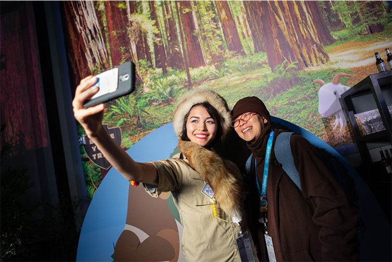 Snapping photos in the Salesforce.org Dreamforce selfie station.