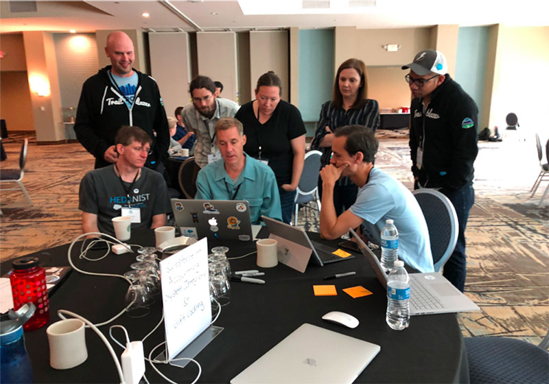 A group of higher education technology enthusiasts discuss the Education Data Architecture at the Salesforce.org Open Source Community Sprint in 2019.