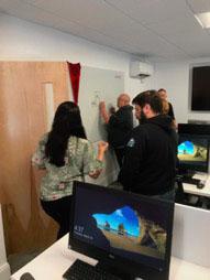 Community members whiteboard ideas for GEM at Northeastern University