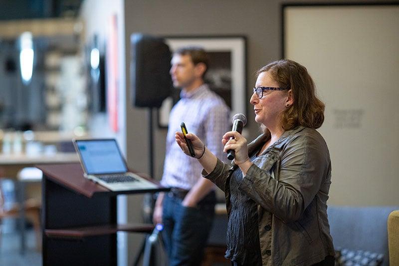 "<a href=""https://www.linkedin.com/in/vneumark/"" rel=""noopener"" target=""_blank"">Valerie Neumark</a>, Full Circle Fund Board of Directors member speaking at an event"