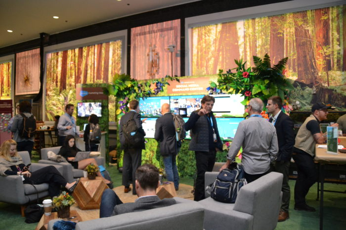 Event attendees exploring the Dreamforce 2018 social media center and enjoying the Marketing Cloud lounge