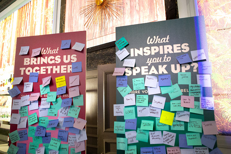 """Posters with sticky notes saying """"What brings us together?"""" and """"What inspires you to speak up?"""" from Dreamforce"""