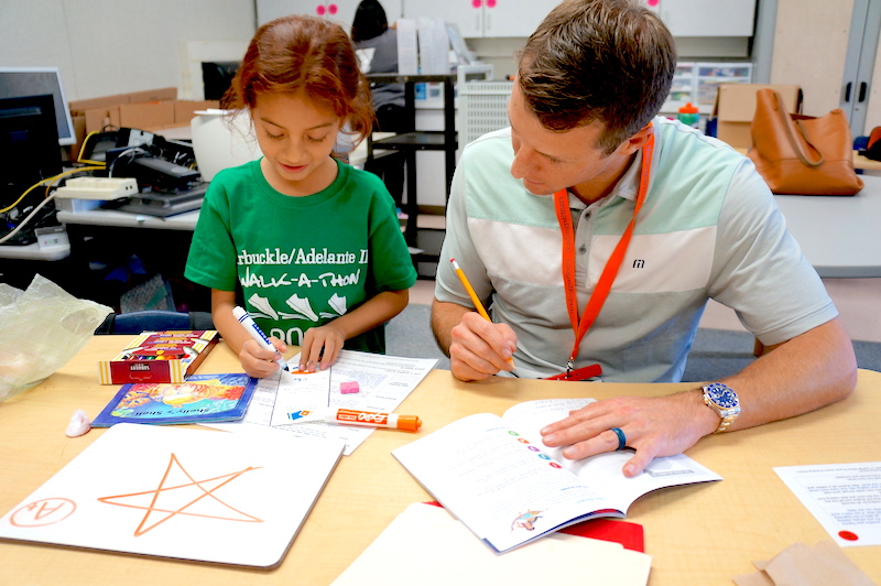 A student with a volunteer tutor