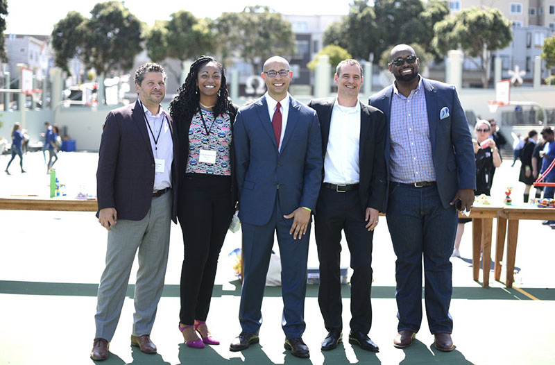 Leaders from Oakland Unified School District, local nonprofits and Salesforce.org at a volunteering day at Presidio Middle School, September 2019