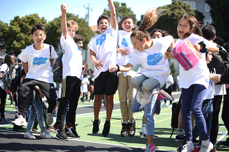 Excited students at a volunteering day with Salesforce at Presidio Middle School