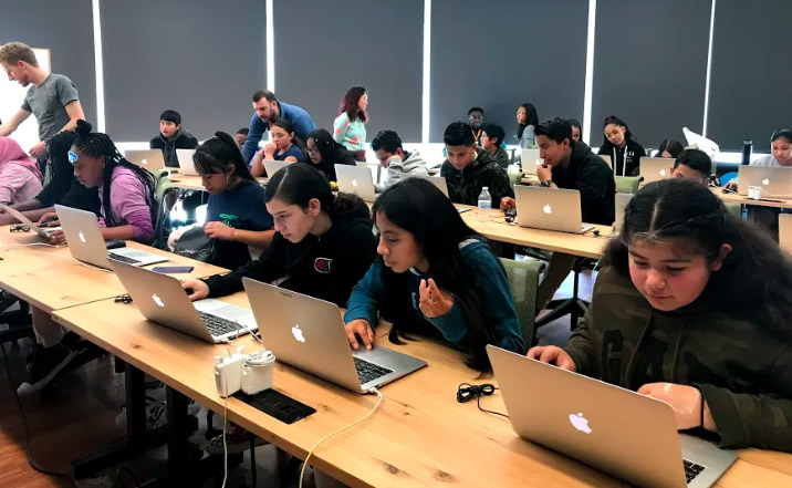 Students learn how to 3D print at an event with Salesforce volunteers.