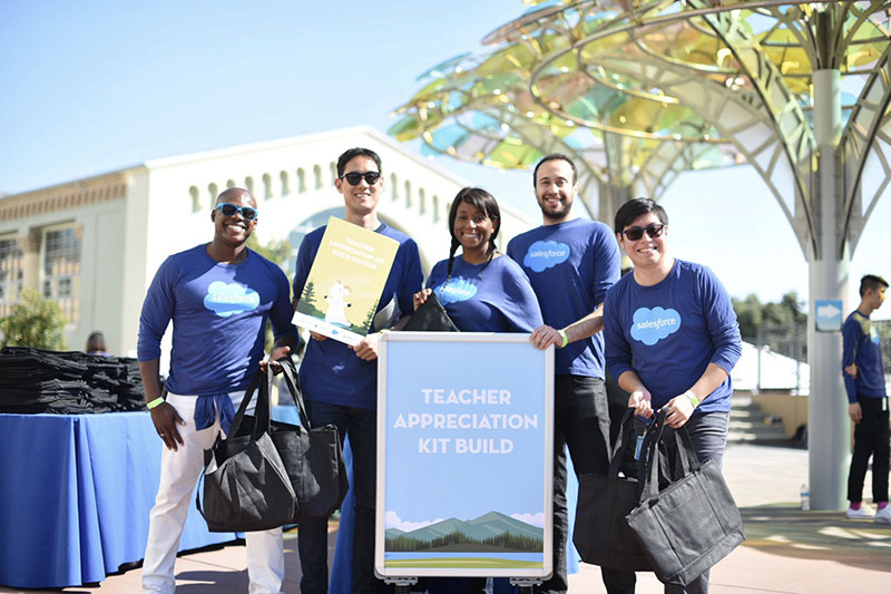 Salesforce employees participating in a kit building activity, with kits to be donated to local Bay Area teachers.
