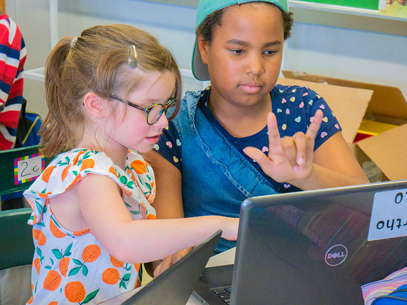 Girls learn to code as part of a Kids Code Jeunesse program. Photo credit: Kids Code Jeunesse