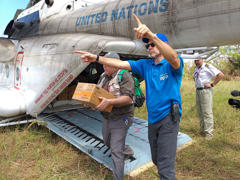 World Food Program response team delivering food after a cyclone hit Mozambique.