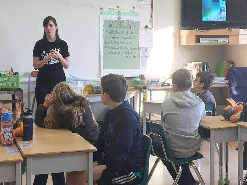 Caitlin Tuba, Data Protection Officer at Traction Guest, teaches code to elementary school kids.