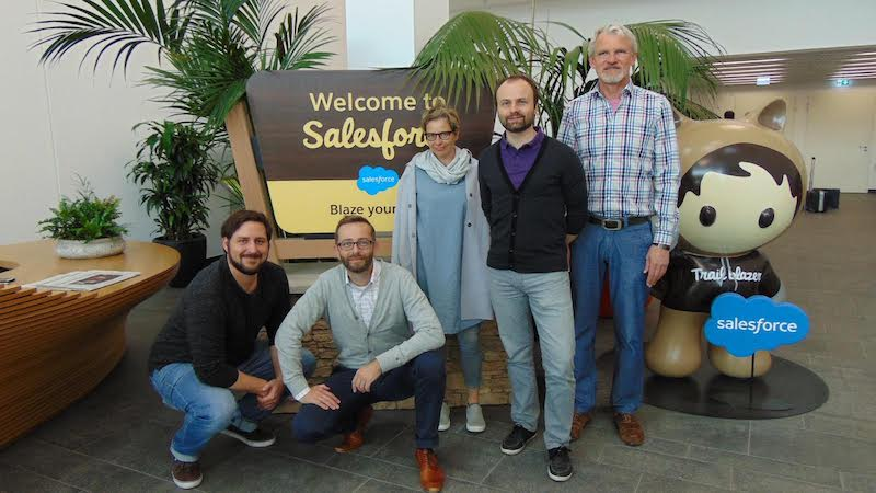 Staff of nonprofit customer, Condrobs e. V. Inside, meet with Salesforce employee, Sebastian Munkelt, at Salesforce's Munich office.