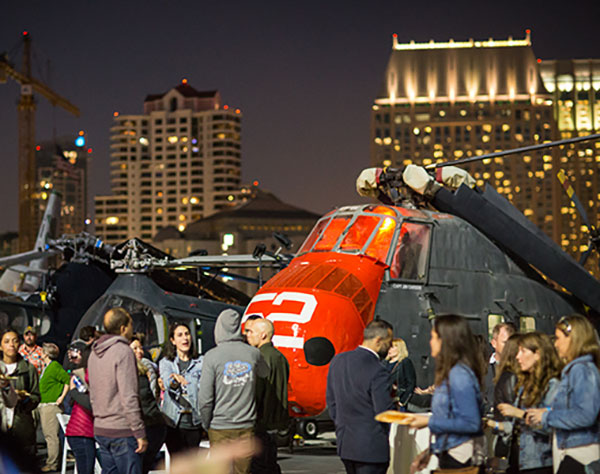 Photo of last year's Higher Ed Summit reception on an aircraft carrier in San Diego