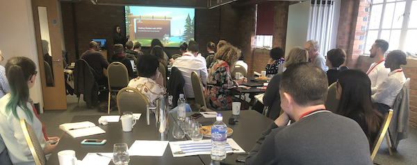 Sara Brophy. A full house at the Salesforce.org Success Summit in Manchester, UK. Success Specialist, Amira Mahjoub, delivering a session on Getting Started with NPSP.