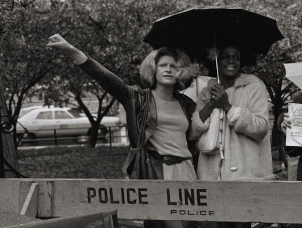 Sylvia Rivera (left), Marsha P. Johnson (second left) and other rights activists gather for a demonstration outside New York City's City Hall in 1973. Photo courtesy of New York Public Library, Manuscripts and Archives Division