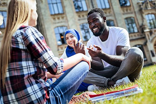 Aalto University students chatting outdoors