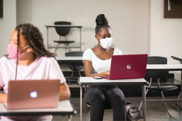 University of Kentucky students wearing masks in class to maintain social distance protocol.