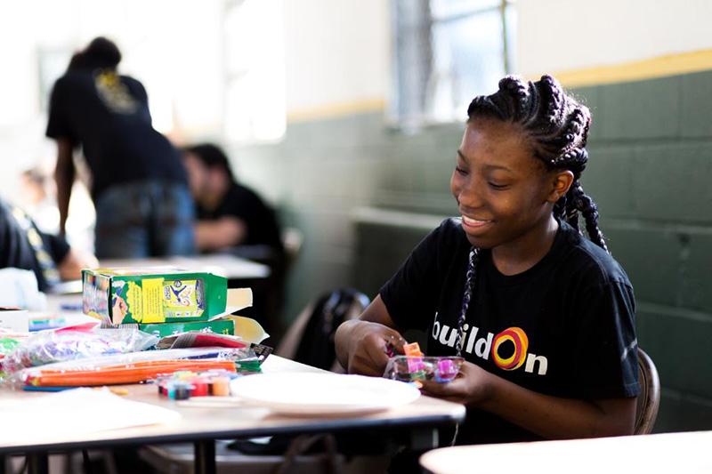Girl sitting at desk making art