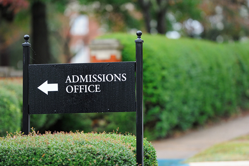 Admissions Office sign on college campus