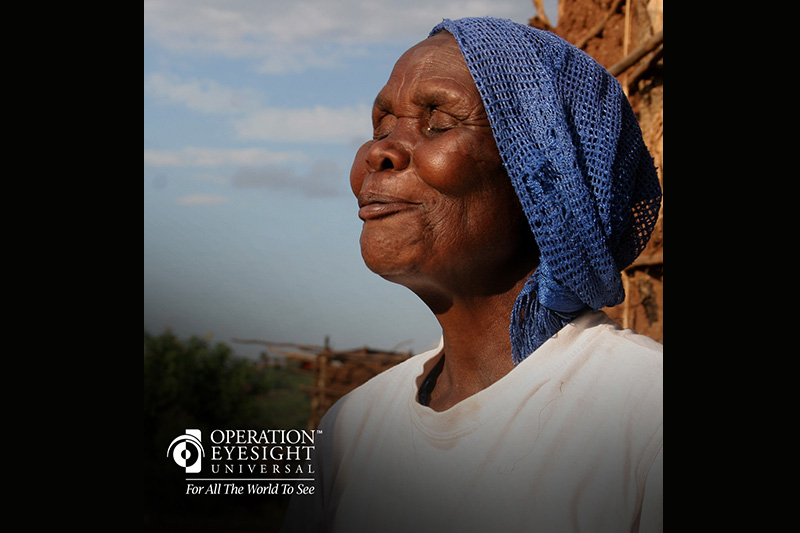 An older woman looking thankful and happy