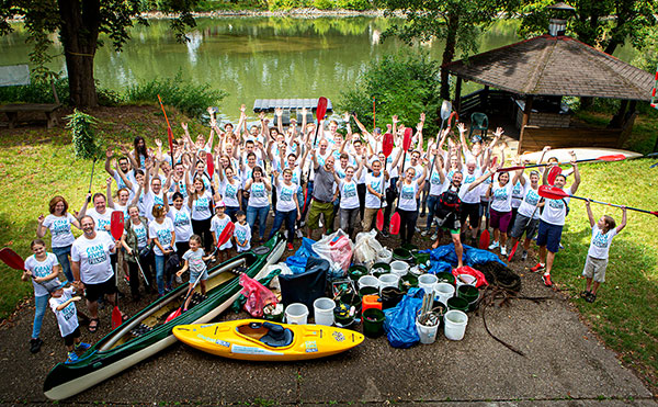 Volunteers enjoying a day of kayaking — and cleaning up the river!