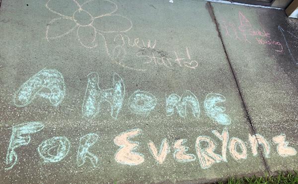 Sidewalk chalk shows a message of positivity