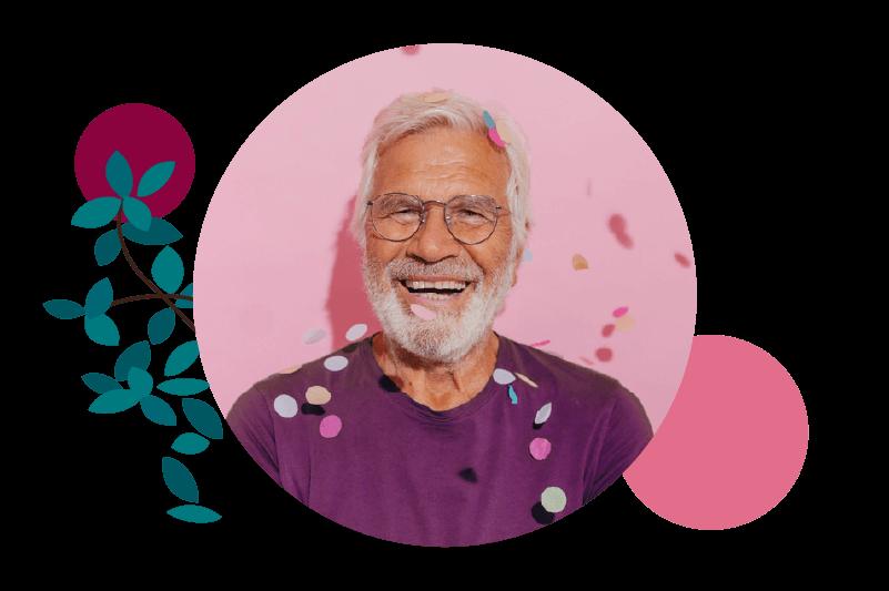 Older Trailblazer with glasses smiling with confetti falling around him celebrating Trailblazers Together
