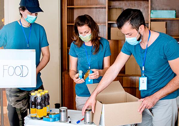 Nonprofit volunteers packing food.