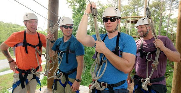 Men doing a ropes course