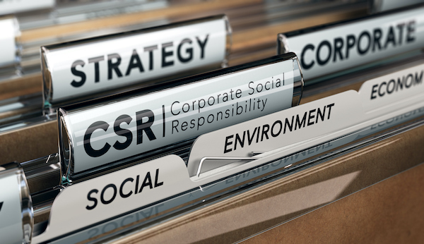 Folder focused on a tab with the acronym CSR, Corporate Social Responsibility.