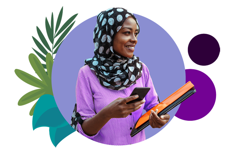 A Trailblazer wearing a headscarf and holding her phone and her laptop checking out the 2020 Summit Awards.