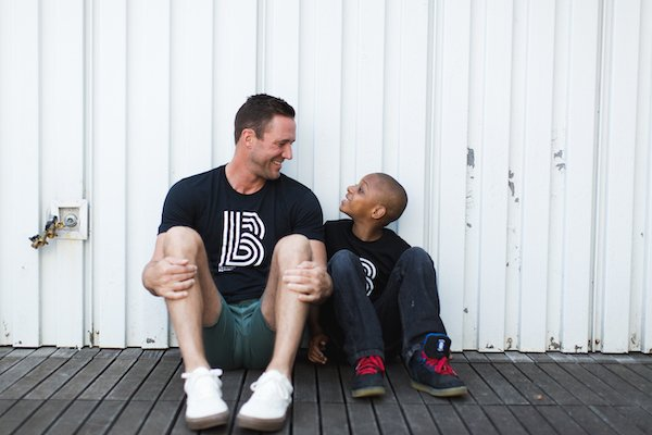Man and young boy sitting and laughing together