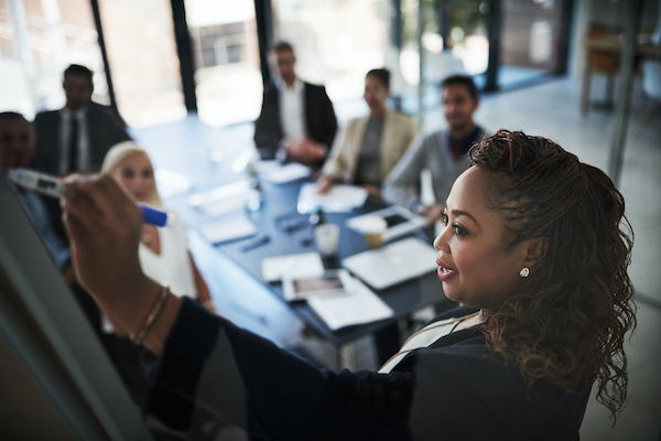 Black woman leading a business meeting