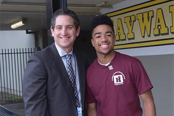 Two men smiling on campus