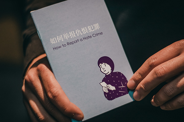 Person holding paper booklet