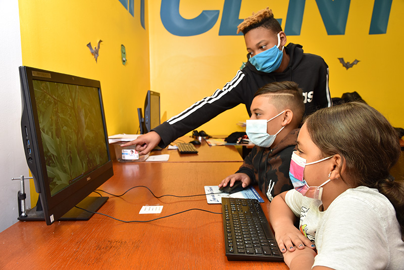 Kids doing virtual learning while wearing masks